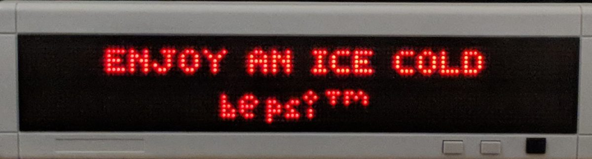 "LED sign reading ""ENJOY AN ICE COLD bepsi (TM)"""